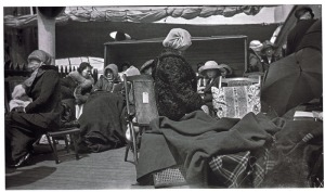 Survivors of the Titanic aboard the Carpathia rested on deck chairs, wrapped against the cold. (Bernice Palmer | Courtesy of Cara E. Bute)