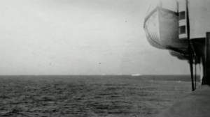 Another photo by Bernice showing the iceberg in the distance and one of the Carpathia life boats. She states that this was the largest iceberg in the area and undoubtedly had to be the iceberg involved in the Titanic collision.