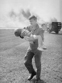 ∫ Spencer Bailey – subject of a famous photograph showing Lt. Colonel Dennis Nielsen carrying the three-year-old survivor to safety.  His brother Brandon also survived the crash, but their mother, Francie, did not.  A statue in part of Sioux City's riverfront development is based on the picture. The 1994 memorial commemorates the rescue efforts by the Sioux City community following the crash, and features contemplative areas and a tree-lined approach with plaques describing the accident. (Wikipedia)