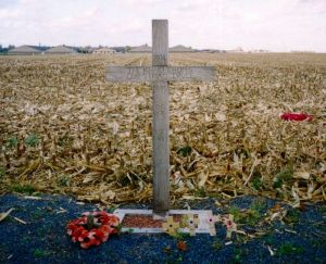 "∫ A cross, left in Saint-Yves (Saint-Yvon - Ploegsteert; Comines-Warneton in Belgium) in 1999, to commemorate the site of the Christmas Truce. The text reads: ""1914 – The Khaki Chum's Christmas Truce – 1999 – 85 Years – Lest We Forget"" (Photo credit Wikipedia)"