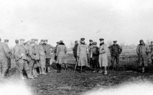 ∫ British and German troops meeting in no man's land during the unofficial truce (British troops from the Northumberland Hussars, 7th Division, Bridoux-Rouge Banc Sector) British and German troops meeting in No-Mans's Land during the unofficial truce. (British troops from the Northumberland Hussars, 7th Division, Bridoux-Rouge Banc Sector). (Credit From Wikipedia)